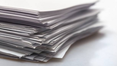 Pile of paper documents on background, close up