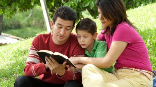 Family enjoying Bible study in nature